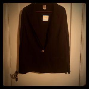 Black blazer and black slacks